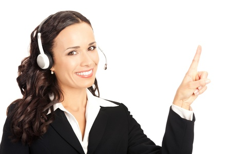 call center agent: Portrait of happy smiling cheerful customer support phone operator in headset pointing at something, isolated on white background Stock Photo