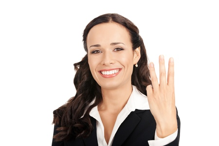 Happy smiling young business woman showing three fingers, isolated on white background photo