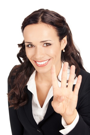 Happy smiling young business woman showing four fingers, isolated on white background photo