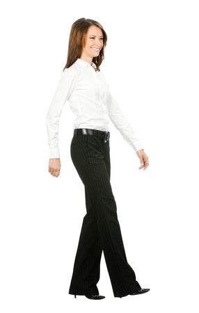 important people: Full body portrait of walking business woman, isolated on white background Stock Photo