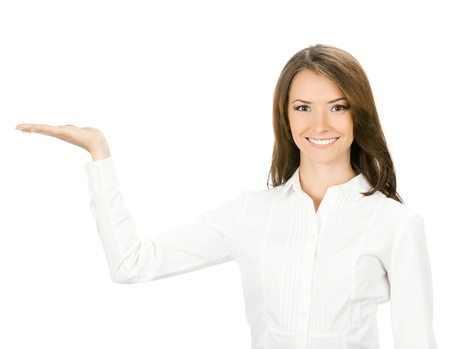 Happy smiling young beautiful business woman showing blank area for sign or copyspace, isolated over white background photo