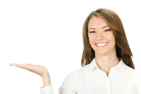 blank area: Happy smiling young beautiful business woman showing blank area for sign or copyspase, isolated over white background