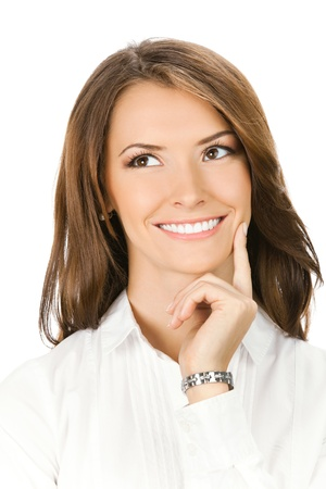 Happy smiling thinking or planning young business woman, isolated over white background photo