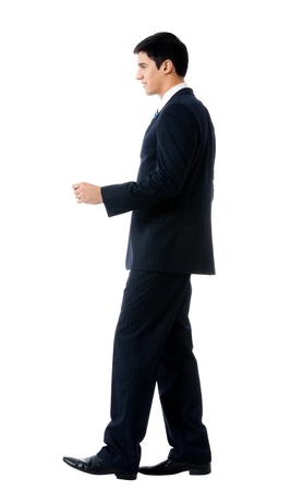 Full body portrait of walking young business man, isolated on white background photo