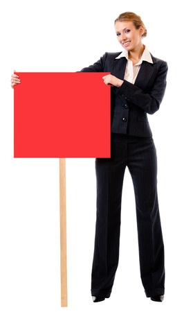 Happy smiling young business woman showing blank red signboard, isolated over white background photo