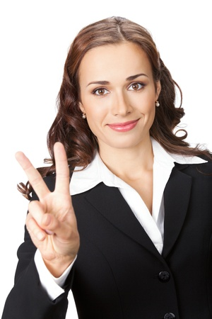 Happy smiling young business woman showing two fingers, isolated on white background photo