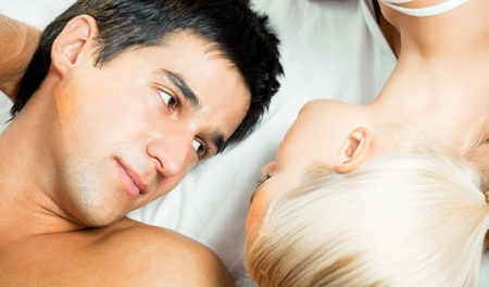 Young beautiful couple making love in bed Stock Photo - 11872938