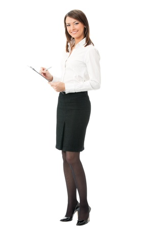 Happy smiling young business woman with clipboard writing, isolated on white background photo