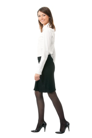to hasten: Full body portrait of walking business woman, isolated on white background Stock Photo