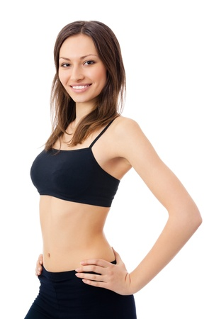 Portrait of beautiful young happy smiling woman in fitness wear, isolated over white background Фото со стока
