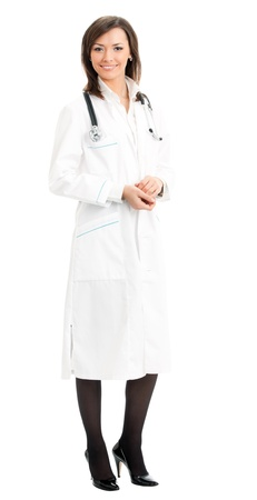 Full body portrait of happy smiling young female doctor, isolated over white background photo