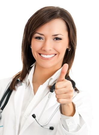 Happy smiling cheerful female doctor with thumbs up gesture, isolated over white background photo