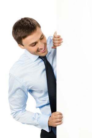 holding a sign: Happy smiling young business man showing blank signboard, isolated over white background