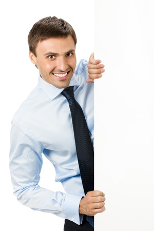 placard: Happy smiling young business man showing blank signboard, isolated over white background