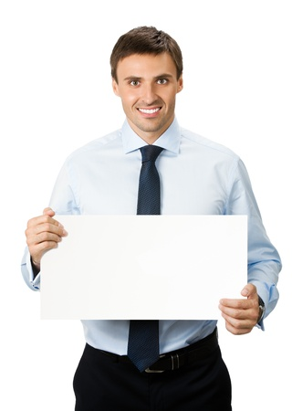 holding blank sign: Happy smiling young business man showing blank signboard, isolated over white background