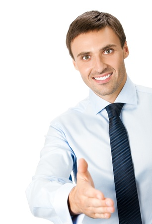 Happy smiling young business man giving hand for handshake, isolated over white background photo