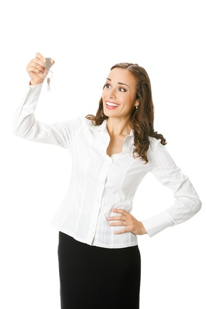 Young happy smiling business woman or real estate agent showing keys from new house, isolated on white background photo
