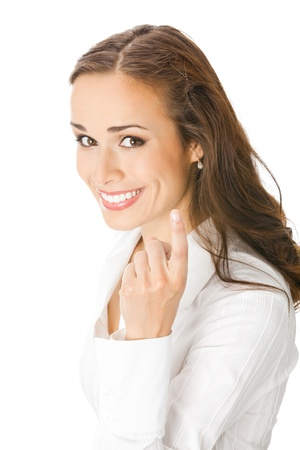 seguito: Ritratto di giovane donna felice di affari sorridente con seguimi gesure, isolato su sfondo bianco Archivio Fotografico