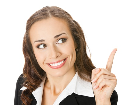 Happy smiling young business woman showing blank area for sign or copyspase, isolated over white background photo