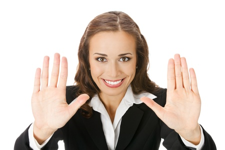 Happy smiling young business woman showing stop gesture, isolated over white background photo
