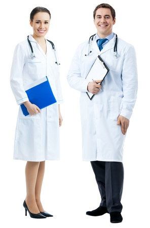 Full body portrait of two happy smiling young medical people, isolated over white background photo