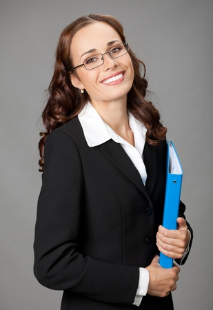 Portrait of happy smiling business woman with blue folder, over gray background Stock Photo - 12234676