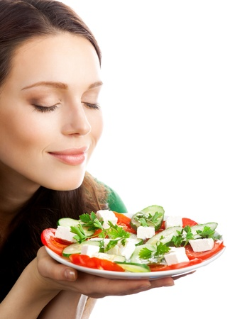 one eye closed: Portrait of happy smiling woman with plate of salad, isolated on white background