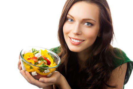 Young happy smiling woman with fegetarian salad, isolated over white background photo