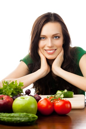 Portrait of happy smiling young woman with vegetarian food, isolated over white background photo