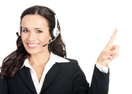 telephone headsets: Portrait of happy smiling cheerful customer support phone operator in headset showing something, isolated over white background