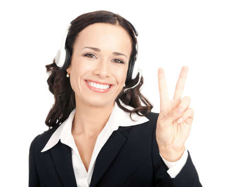 Portrait of happy smiling cheerful customer support phone operator in headset showing two fingers, isolated on white background photo