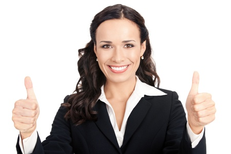Happy smiling young business woman showing thumbs up gesture, isolated over white background photo