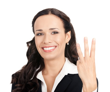 Happy smiling cheerful young business woman showing three fingers, isolated over white background photo