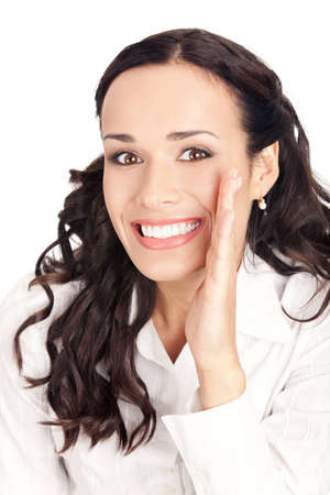 Portrait of happy smiling young business woman covering with hand her mouth, isolated on white background photo