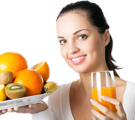 over eating: Portrait of happy smiling young woman with assorted citrus fruits and glass of orange juice, isolated over white background