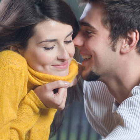 Portrait of young happy smiling cheerful couple outdoors Фото со стока