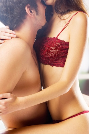 Young beautiful amorous couple making love in bed Stock Photo - 12910773