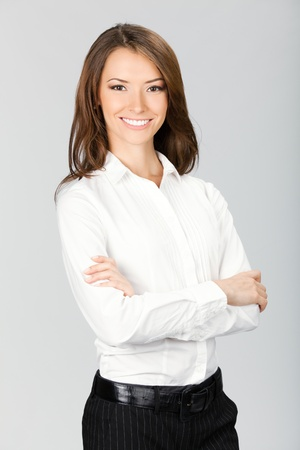 Portrait of happy smiling business woman, over gray background photo