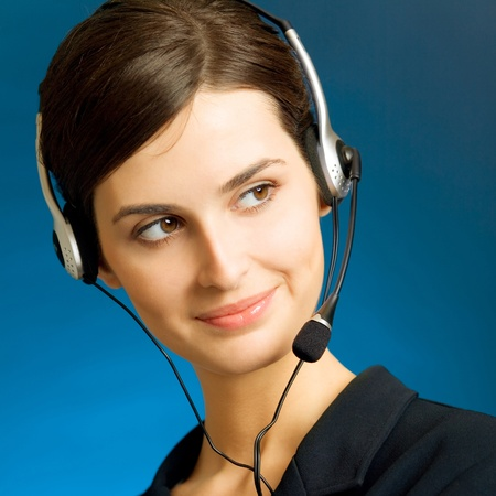 Portrait of happy smiling cheerful customer support phone operator in headset, over blue background Stock Photo - 12926663