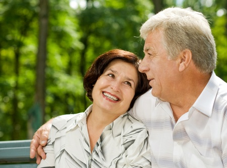 Portrait of attractive senior happy smiling cheerful couple embracing, outdoors photo