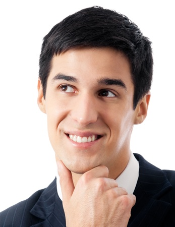 Happy smiling cheerful thinking or planning young businessman, isolated over white background photo