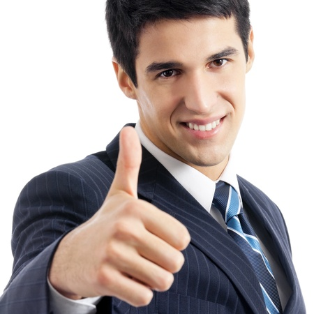 Happy smiling young business man with thumbs up gesture, isolated over white background photo