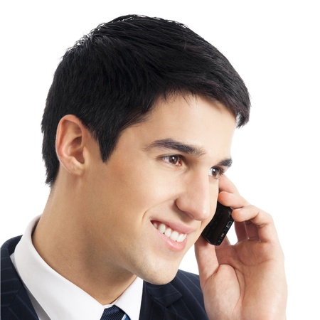 Happy smiling cheerful business man with cellphone, isolated over white background photo