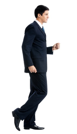 to hasten: Full body portrait of walking young business man, isolated over white background