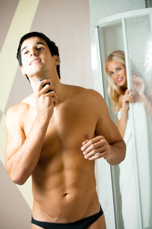Shaving man and young woman at bathroom Stock Photo - 12995476