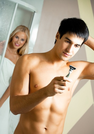 Shaving man and young woman at bathroom Stock Photo - 12995446