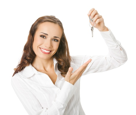 Young happy smiling business woman or real estate agent showing keys from new house, isolated over white background Stock Photo - 12995434