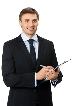 Happy smiling young businessman with clipboard writing, isolated over white background photo