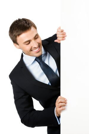 blank area: Happy smiling young business man showing blank signboard, isolated over white background