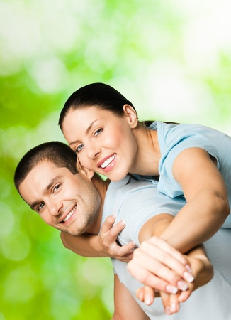 amorous: Portrait of young happy smiling cheerful attractive amorous couple, outdoors Stock Photo